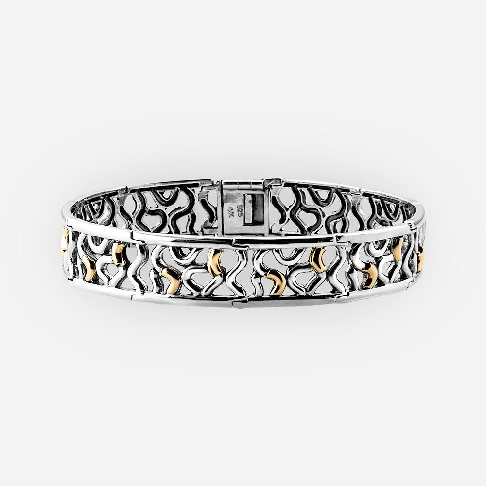 Pulsera de plata en forma abstracta con acentos de oro de 14k.