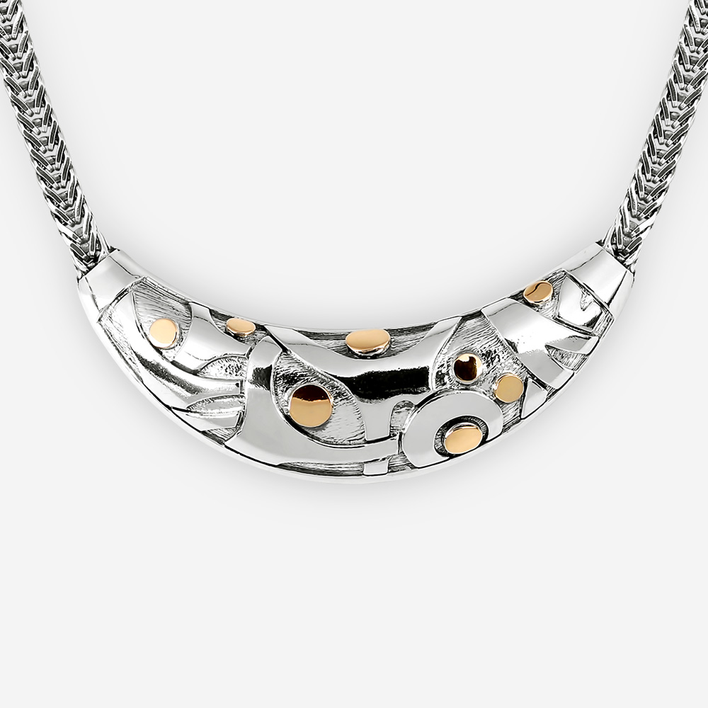 Abstract silver statement necklace with 14k gold dots.