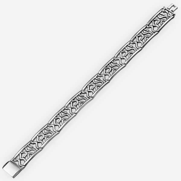 Abstract sterling silver bracelet features an abstract cut out design on each link and a beautiful high polished finish.