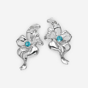 Blue topaz flower earrings in sterling silver with openwork details.