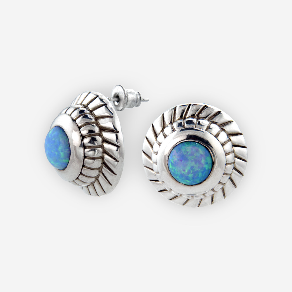 Carved sterling silver opal medallion posts are crafted from oxidized 925 sterling silver, opal cabochons, and 925 sterling silver post backings.