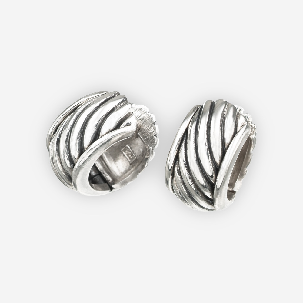 Carved twisted cable huggie hoop earrings crafted from oxidized 925 sterling silver with huggie closures.