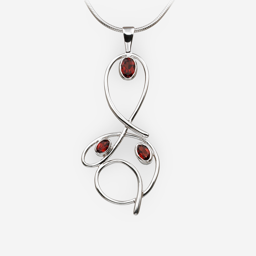 Curved sterling silver garnet pendant with high polished finish.