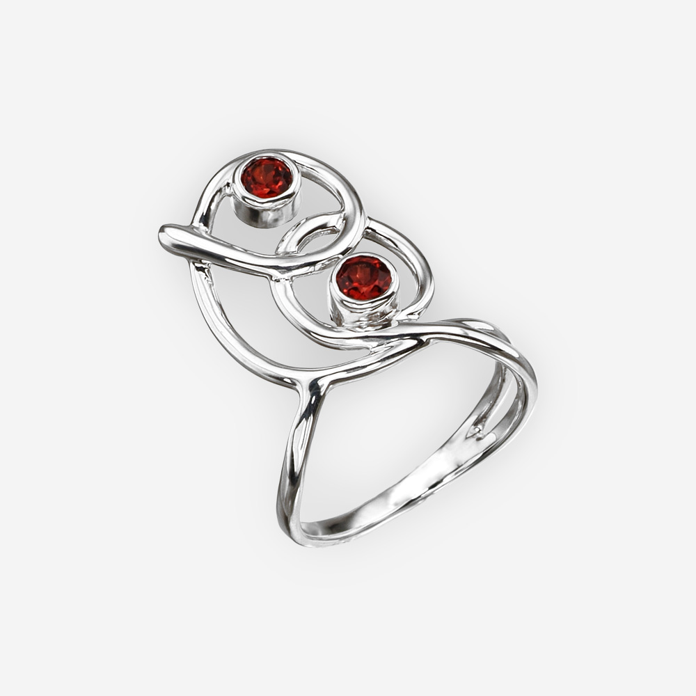 Curved sterling silver garnet ring with a modern abstract curved design.