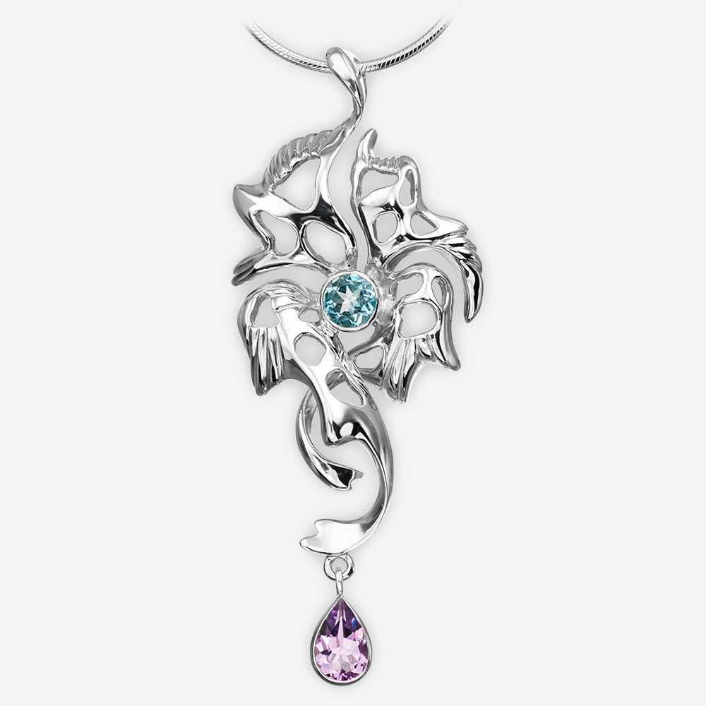 Silver blue topaz and amethyst drop pendant crafted in 925 sterling silver.