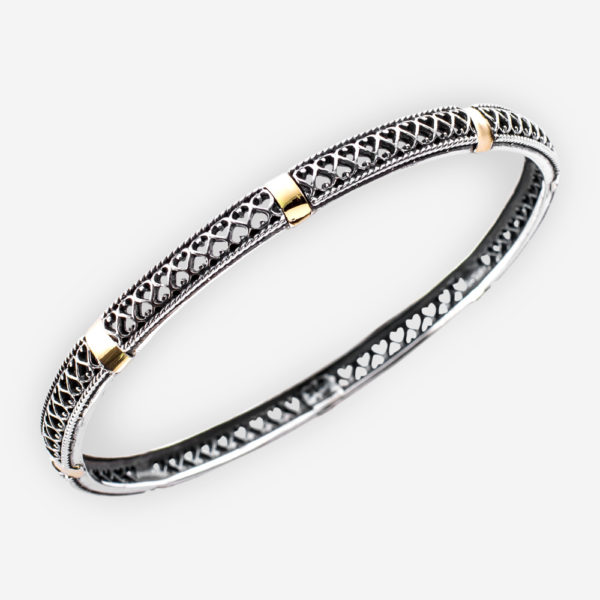 Delicate two tone silver bangle bracelet with silver open filigree design and golden accent details.
