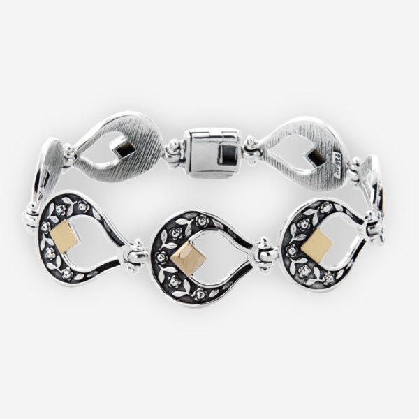 Sterling Silver and 14k Gold Link Bracelet. Features a yemenite carved motif.