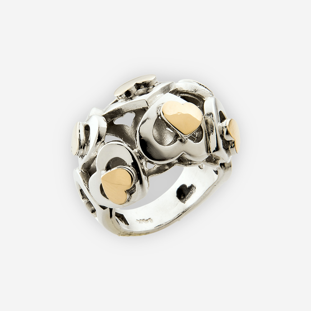 Domed silver cutout heart ring is crafted from 925 sterling silver and 14k gold with a polished finish.
