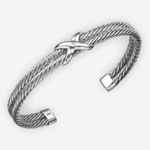 Sterling silver twisted cable cuff is made of two bracelets with twisted cable pattern and a crossed focal point.