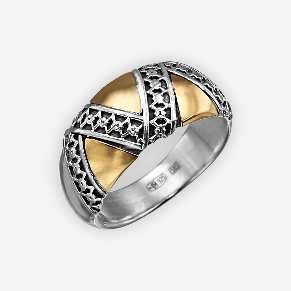 Exotic silver geometric ring is crafted from oxidized 925 sterling silver and 14k gold accents with small flower details.