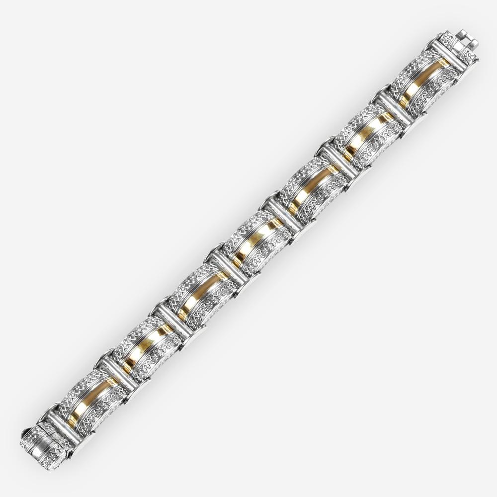 Brazalete de enlace Ecotic hecha a mano de plata .925 y oro de 14k con pequeños detalles complejos.