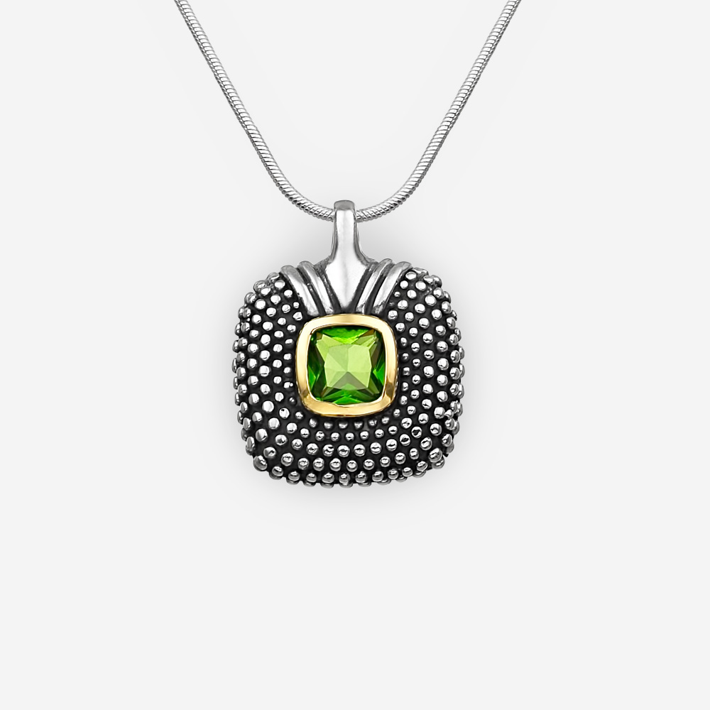 Square exotic silver pendant with green cubic zirconia set in 14k gold.