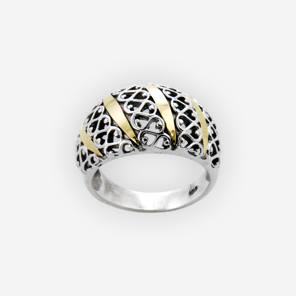 Exotic two tone filigree ring features both 14k gold and sterling silver detailing.