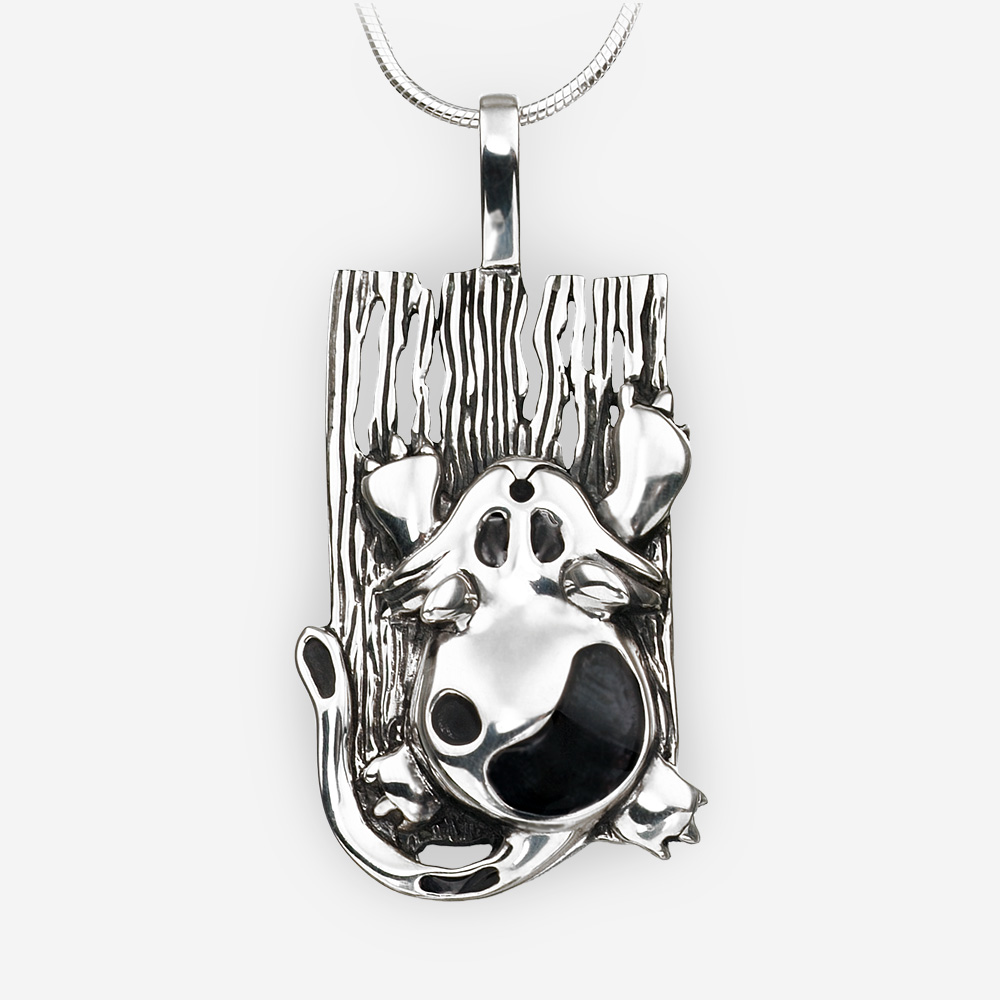 Fantasy sterling silver cat pendant with an oxidized finish.