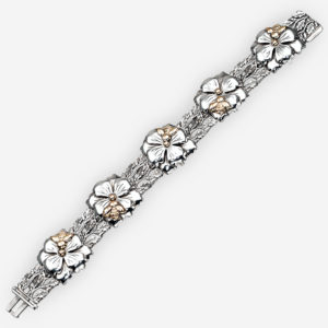 Floral silver bracelet with five flower links and 14k gold bee accents.