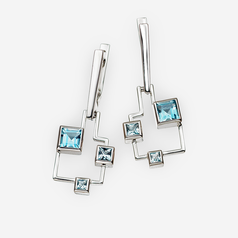 Geometric silver blue topaz earrings crafted from 925 sterling silver.