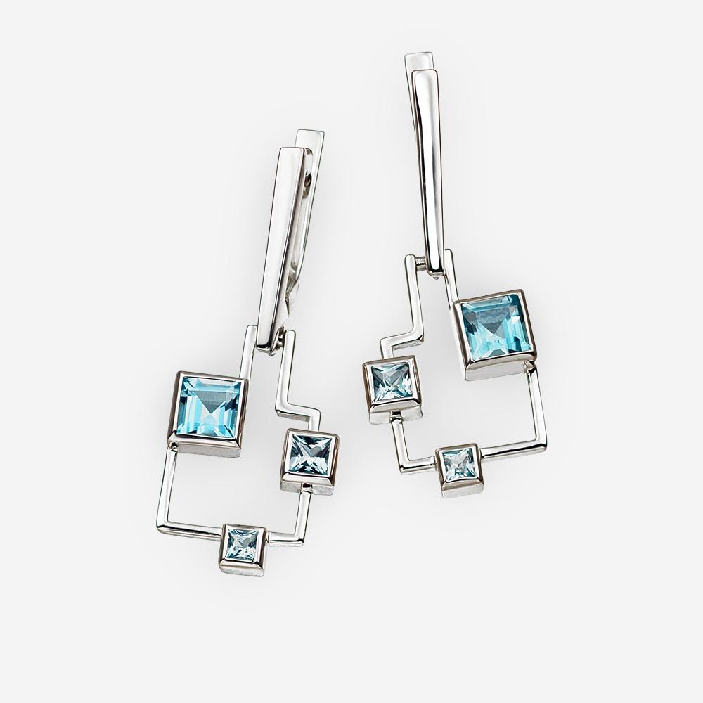 Aretes geométricos con topacio azul hechos de plata fina de .925.