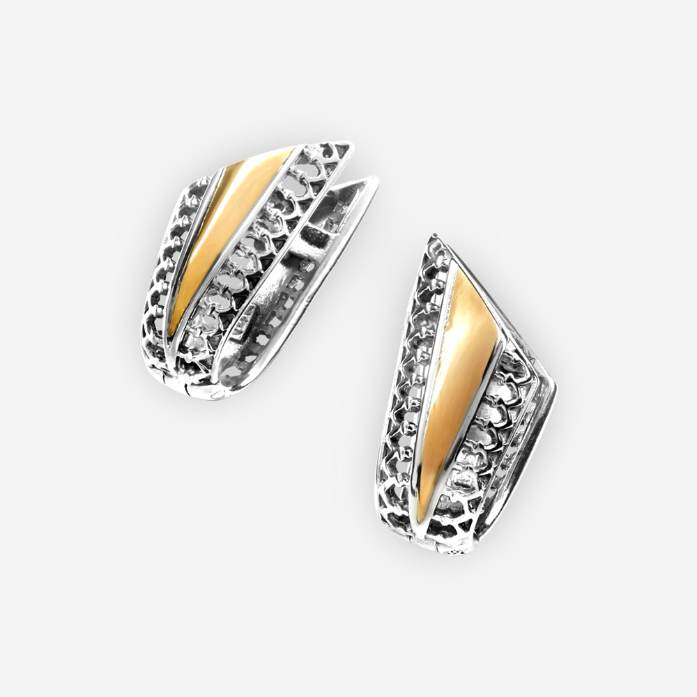 Modern two tone silver earrings with filigree details, gold accents, and huggie closure.
