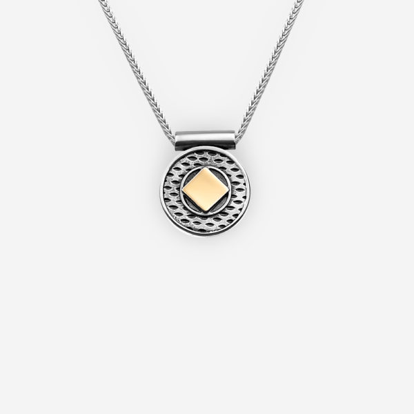 Two tone silver necklace with sterling silver geomtric elements and gold accent details on a silver chain.