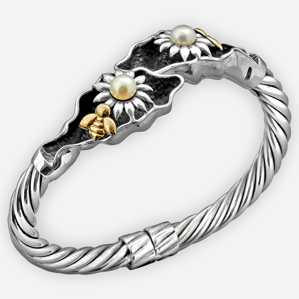 Gold bee silver bangle with flower motifs set with pearls and 14k gold bees.