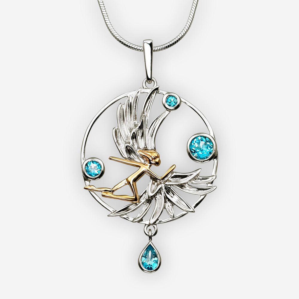 Golden angel silver pendant with multiple blue topaz gemstones.