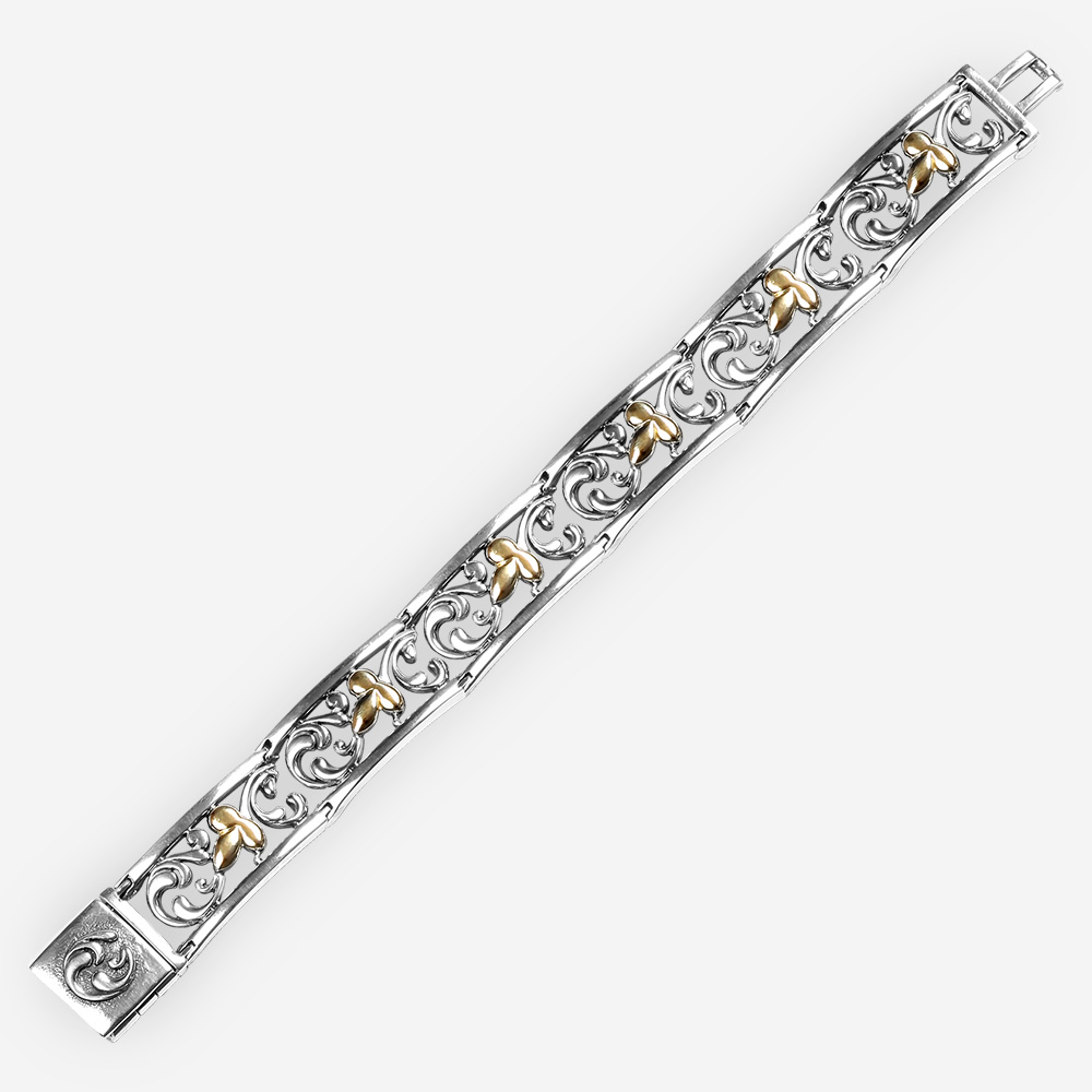 Two tone delicate silver bracelet with 14k gold leaves design and filigree background.