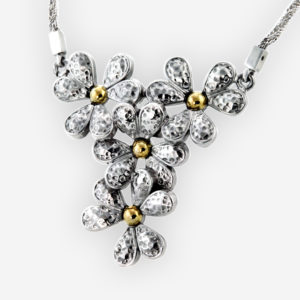 Hammered silver flower necklace is carfted from 925 sterling silver with 14k gold pistils.