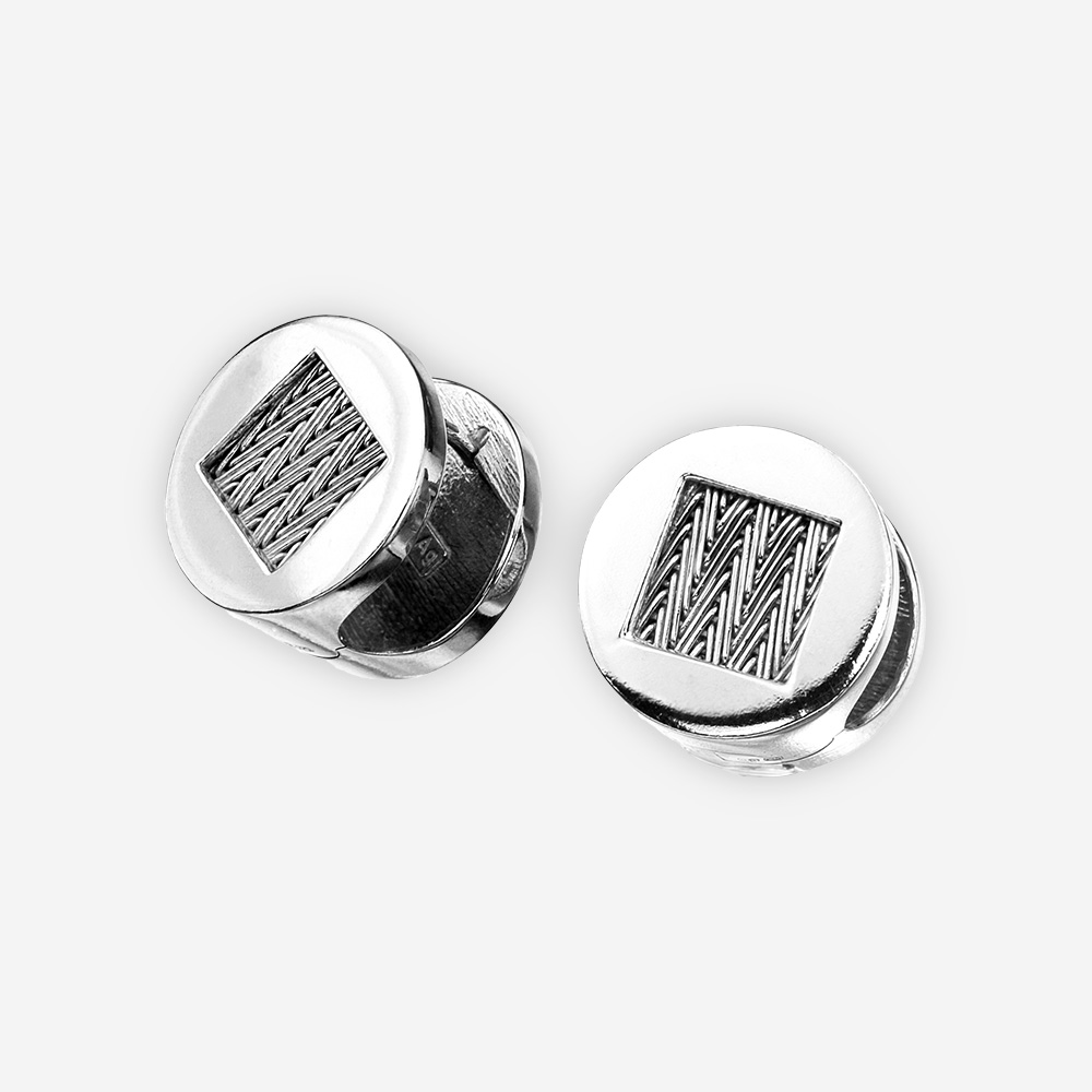 Handwoven silver round herringbone earrings with huggie closures.