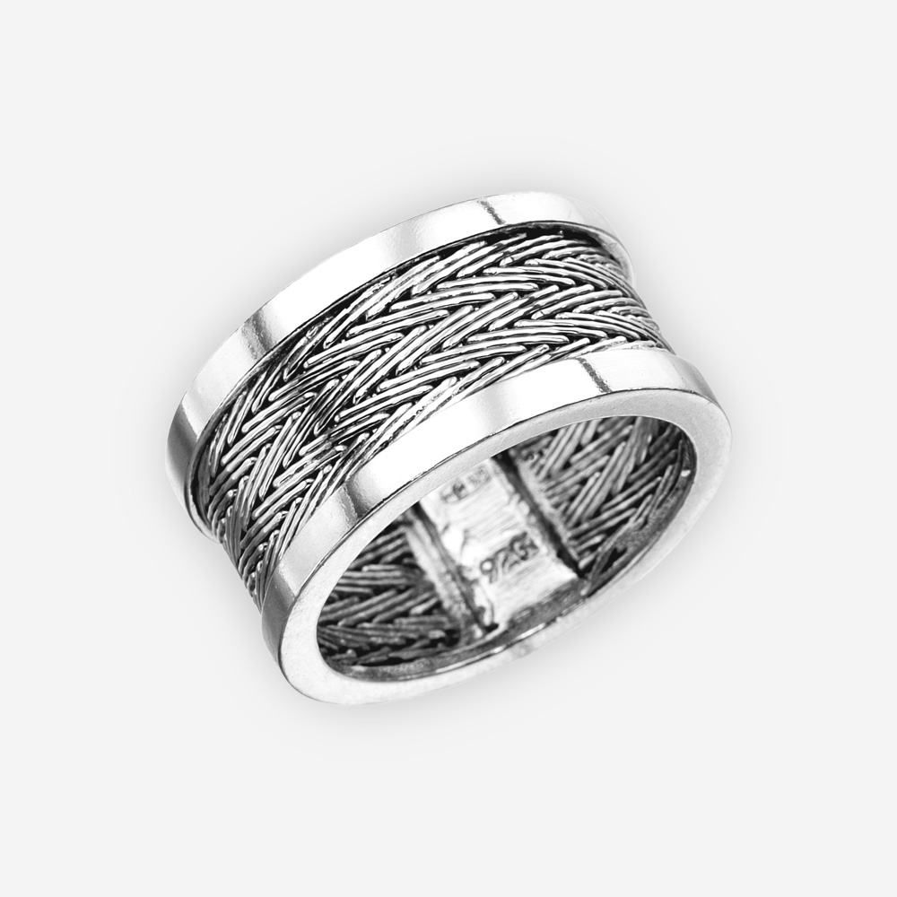Handwoven sterling silver ring with a herringbone weave pattern.