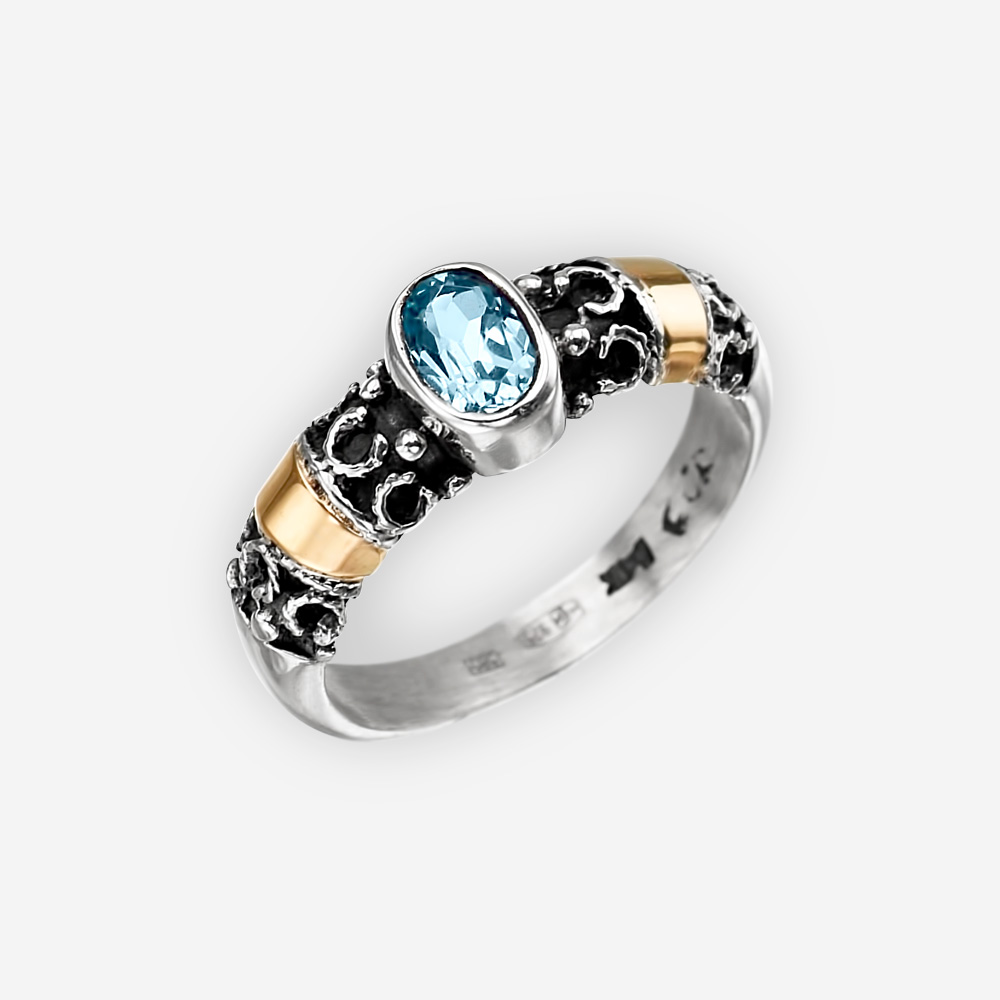 Intricate silver ring crafted in 925 sterling, 14k gold, and set with a faceted gemstone.