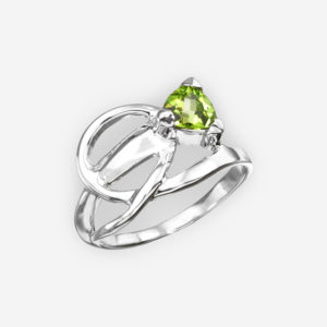 Knotted sterling silver peridot ring with a high polished finish.