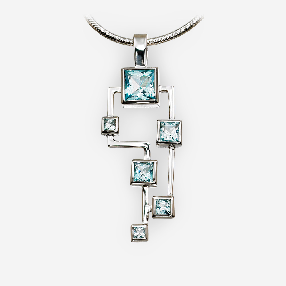 Large geometric silver blue topaz pendant crafted in 925 sterling silver.