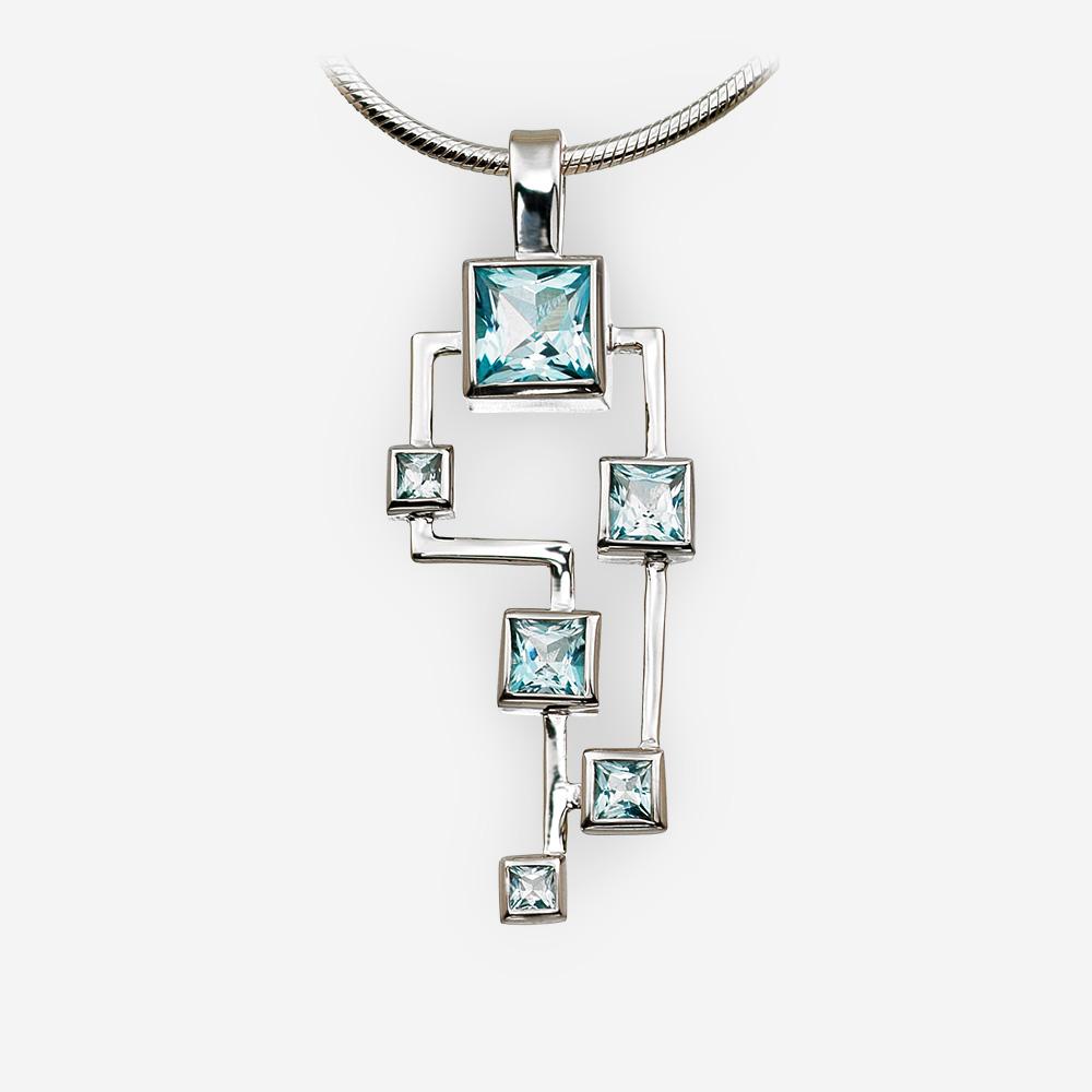 Pendiente geométrico de plata con azul topacio hecho de plata .925.