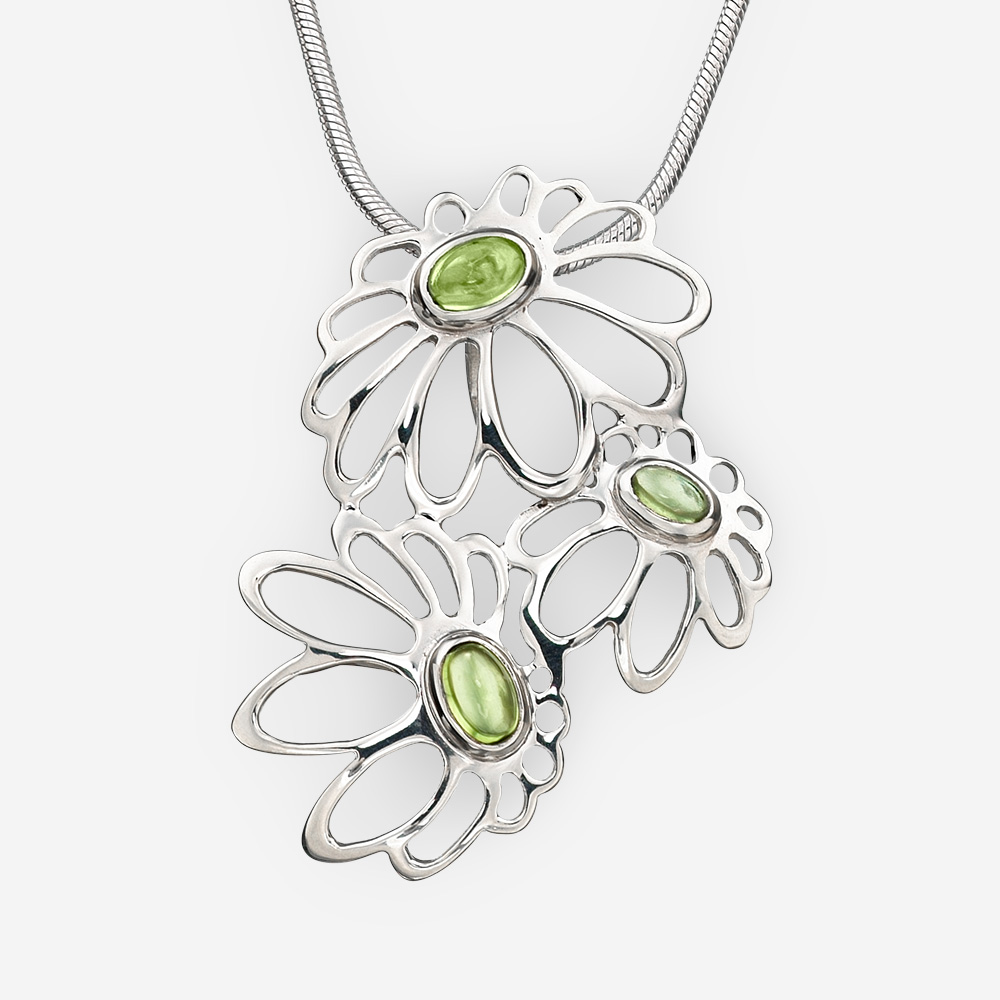 Large silver daisies pendant with peridot crafted from 925 sterling silver.