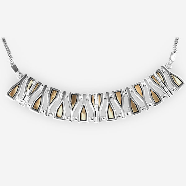 Large silver geometric fragments collar necklace crafted from 925 sterling silver and 14k gold on a silver chain.
