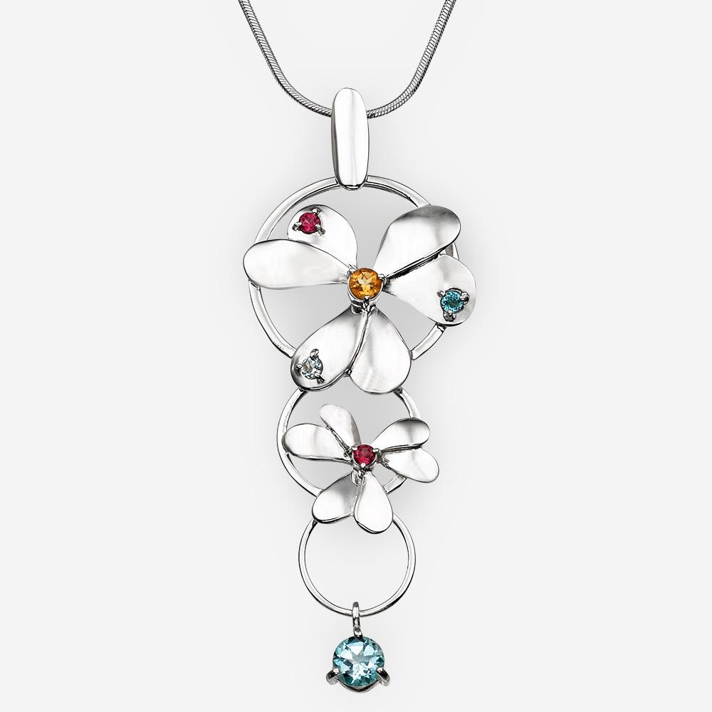 Pendiente de flores de plata con piedras preciosas de citrina, granate y topacio azul.
