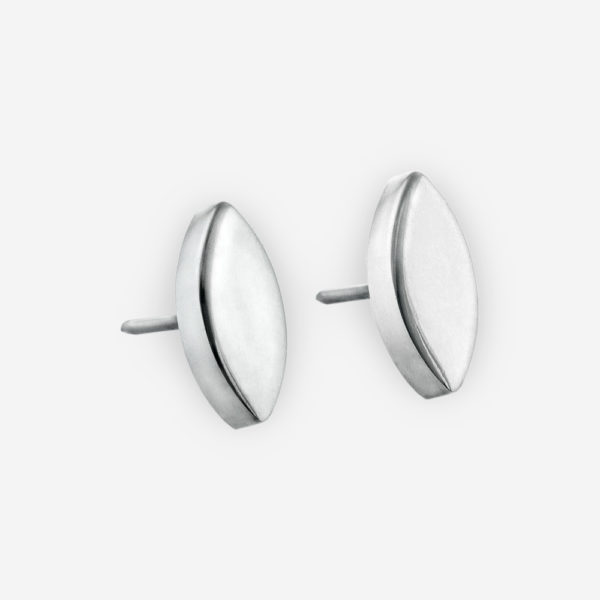 Minimalist silver flower petal posts are crafted from 925 sterling silver with post backings.