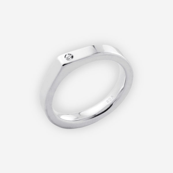 Modern dimensional sterling silver ring features modern angular upper set with a CZ.