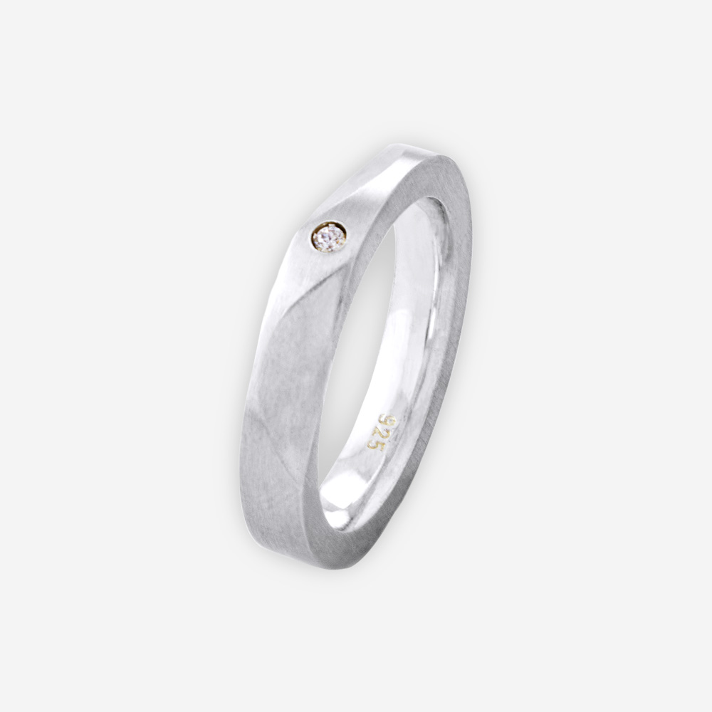 Modern minimalist cubic zirconia silver band featured alternating bevelled edges and a CZ stone.