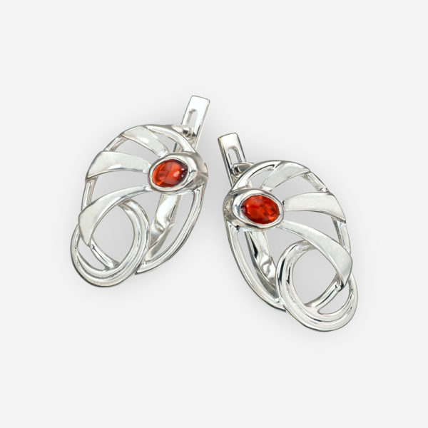 Modern silver garnet earrings with abstract sun beam design and latch back closures.