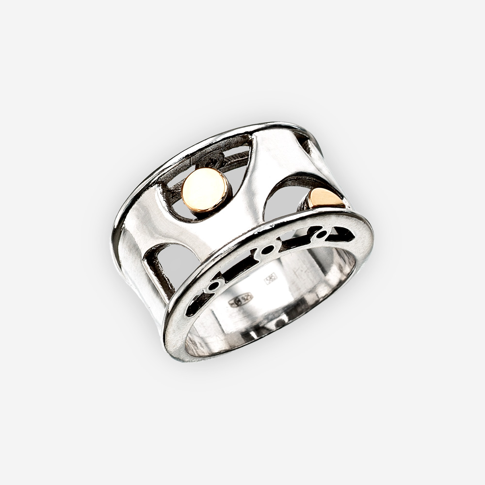 Modern silver statement ring with 14k gold dots and crafted in 925 sterling silver.