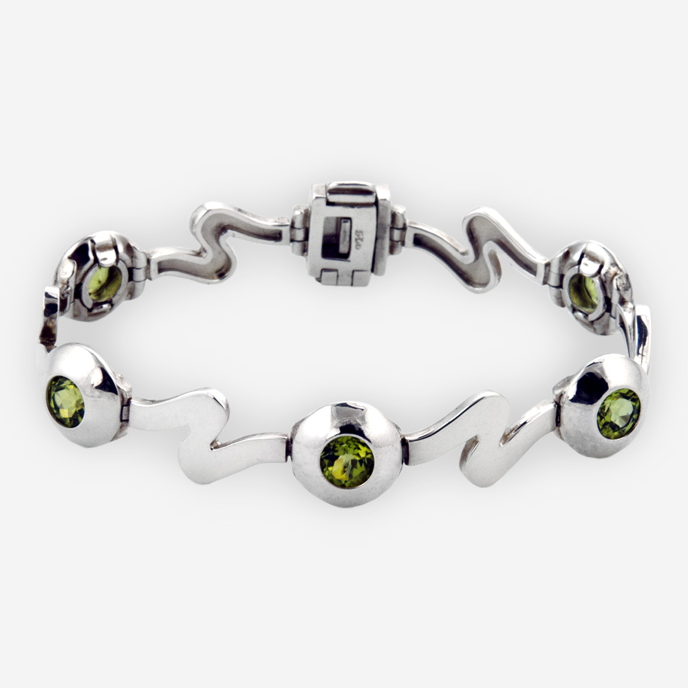 Modern silver wave link bracelet crafted in 925 sterling silver with modern wave and gemstone links.