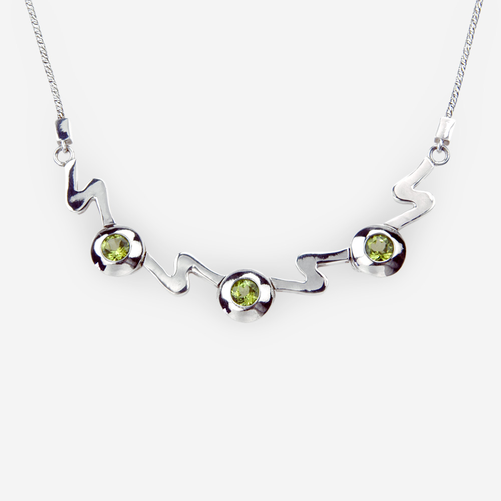 Modern silver wave necklace crafted from polished 925 sterling silver, faceted gemstones, and a 925 sterling silver chain.