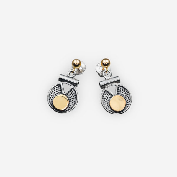 Two tone sterling silver dangle earrings with textured medallions, a geometric cut out design, contrasting 14k gold circle details and 14k posts.