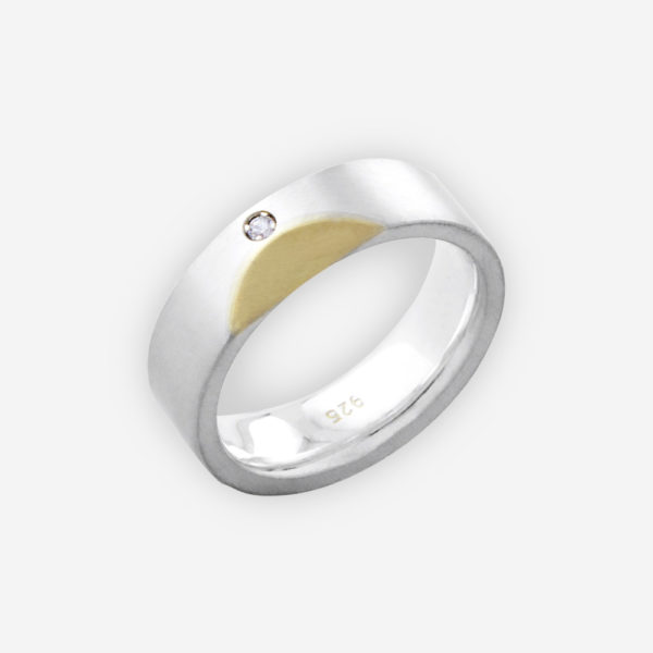 Modern unisex two tone silver band is crafted from 925 sterling silver and 14k gold set with small CZ stone.