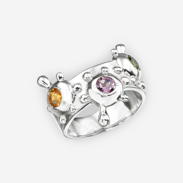 Multi-gemstone abstract silver ring with citrine, amethyst, and peridot gems.