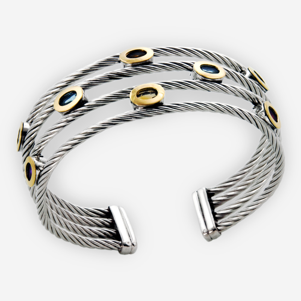 Multi-strand twisted cable cuff bracelet crafted from 925 sterling silver and 14k gold with multiple gemstones.