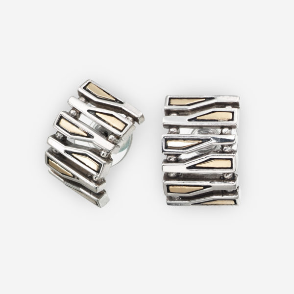 Narrow silver geometric fragments post earrings crafted from 925 sterling silver and 14k gold accents with post backings.