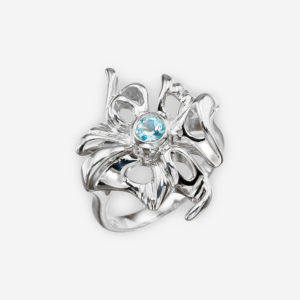 Openwork blue topaz flower silver ring crafted from 925 sterling silver.