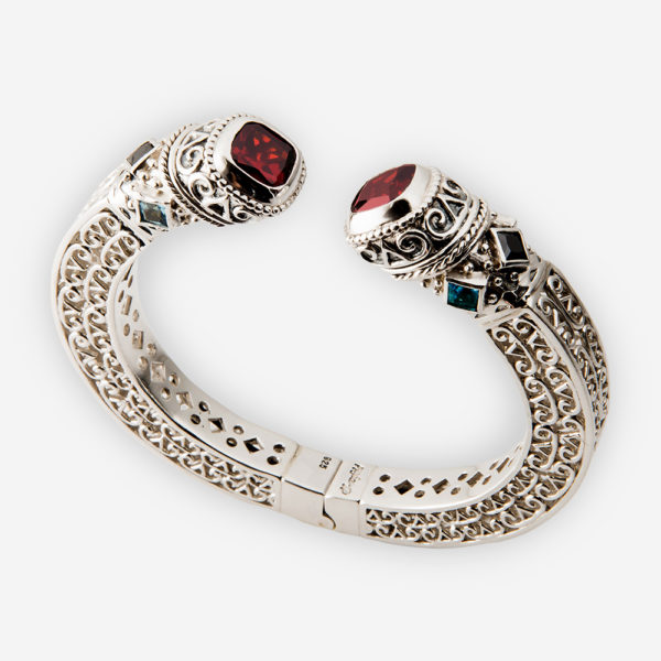Sterling silver bangle with filigree detailing and set with blue and red cubic zirconia stones.